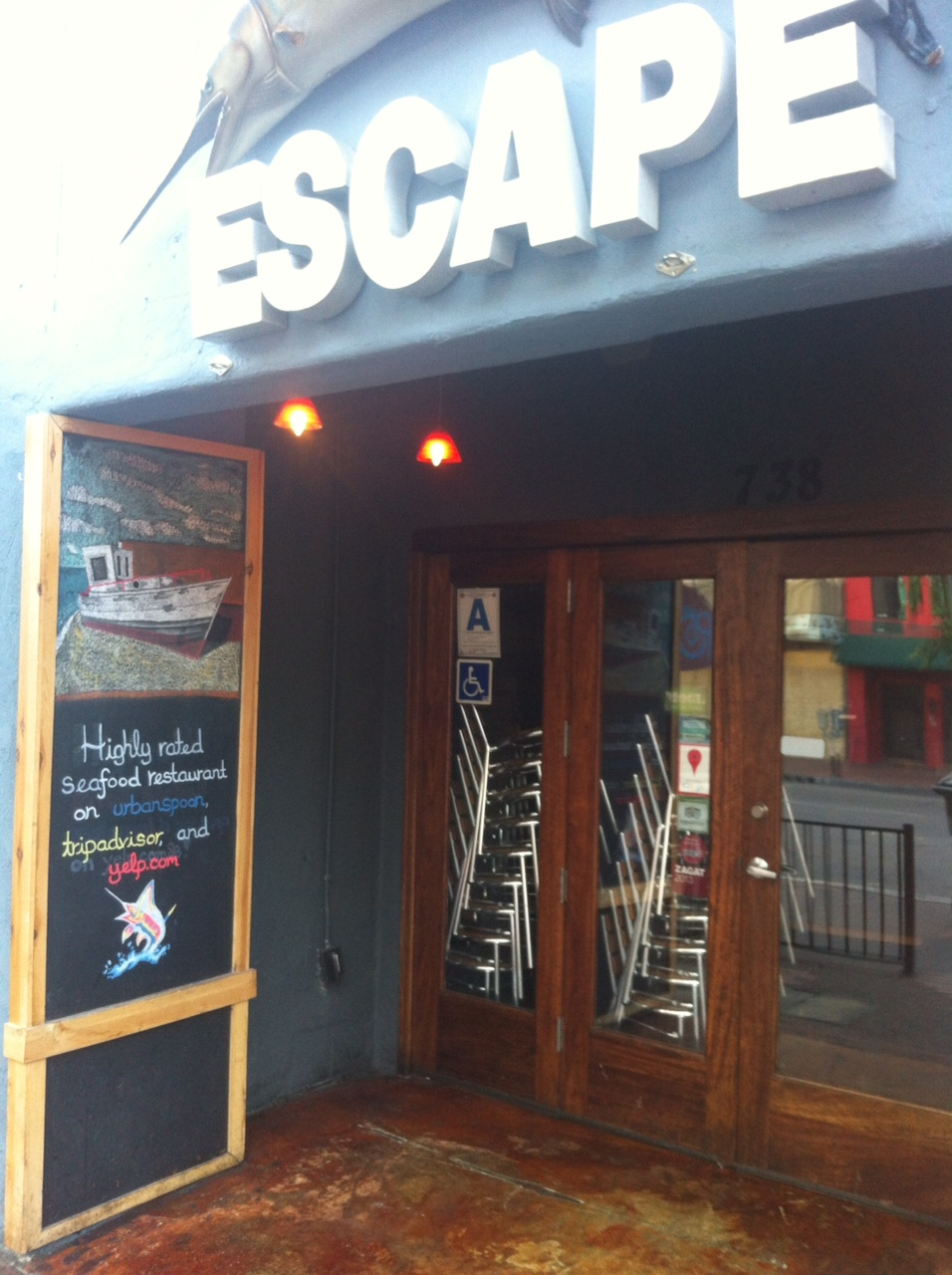 Escape restaurant in San Diego highlights review sites in window... and chalkboard!