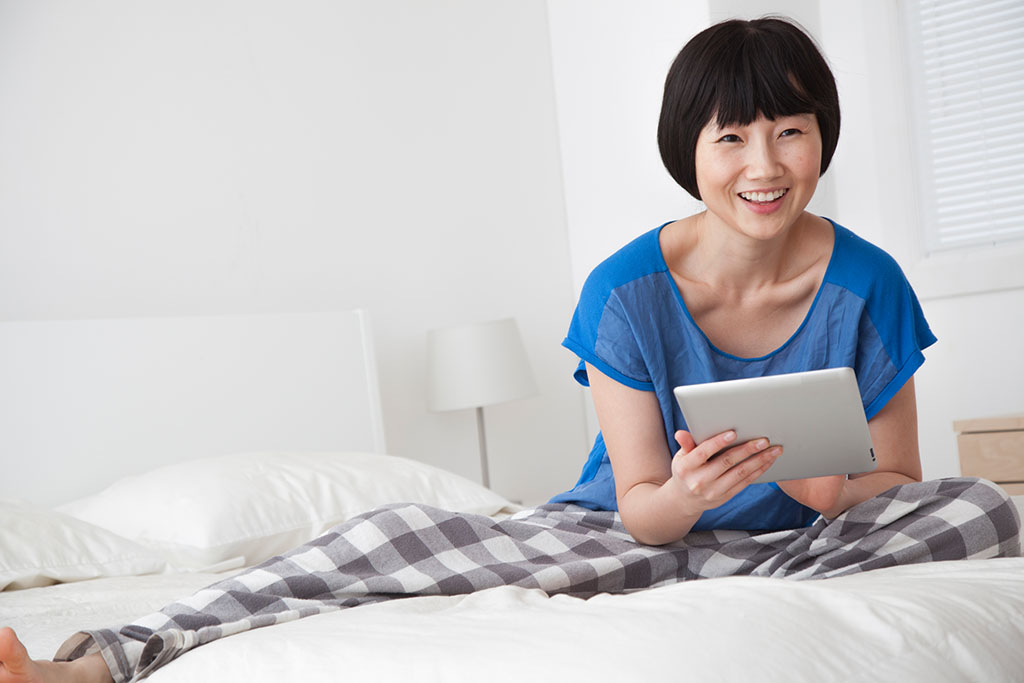 Chinese Woman searching on tablet